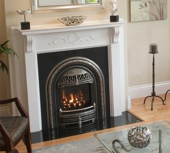 The WINDSOR can be used as a fireplace system for new construction or as a gas insert into an existing fireplace. (Fits into very small fireplaces) Unique coal effect fire and English style cast iron front. From Victorian Fireplace Shop - http://www.gascoals.com/GASFires/GasInserts/WINDSORDirectVent.aspx