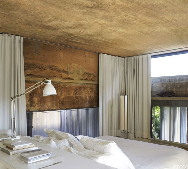 Spanish architect Ricardo Bofill transformed an abandoned cement factory in Barcelona into his home, using mottled concrete salvaged from the building for the master bedroom walls.