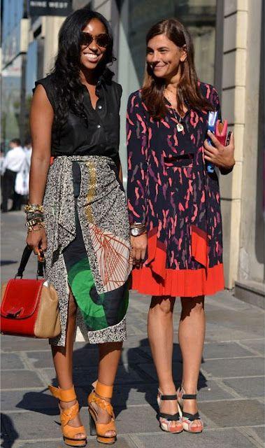 This wrap skirt is soooooooo yummy. Me want! Mix prints + printed skirt + print dress + color block bag + orange sandals #AfricanPrints #kente #ankara #AfricanStyle #AfricanInspired