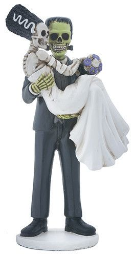 Frankenskull and the love of his life have finally decided to tie the knot! This statue shows Frankenskull carrying his bride! He is wearing a grey suit with black shoes. She is wearing a beautiful wh