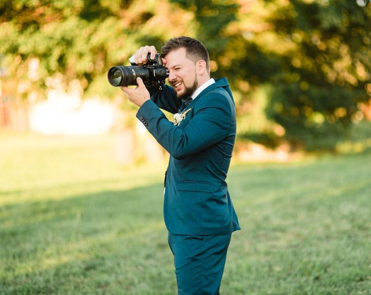 When the groom is a photographer and can't help himself taking a few snaps of his beautiful wife  Right @herman_peter? :p