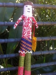 Unique Beaded Artwork.  Made in South Africa.  31cm high lady made by dissadvantage people in the township of Cape Town.  Thank you for choosing me. Make us welcome in your home. And only $30