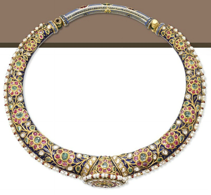 AN ENAMEL AND MULTI-GEM HASLI NECKLACE   The tapered gold collar set on one side with ruby, emerald and diamond flowers, on a dark blue enamel background, the reverse applied with green, red, white and blue enamel depicting a peacock and flower patterns, trimmed with a line of seed pearls and centering upon a circular rosace of diamonds, rubies and emeralds, India, 19th Century, 51.0 cm, in fitted case
