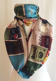A scarf covered with literary classics. Gorgeous book clothes to buy for a bookworm.