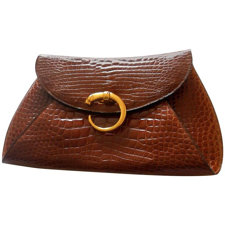 RARE Cartier Panthere Vintage clutch | From a collection of rare vintage clutches at https://www.1stdibs.com/fashion/handbags-purses-bags/clutches/
