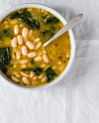 Lemony Kale and White Bean Soup -- DELICIOUS!  8 g fat / 250 cal per giant (2 cup!) bowl as written.