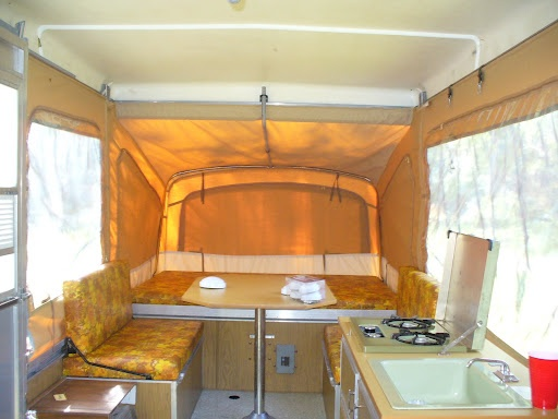 Now THIS brings back childhood memories. Inside of an 80s popup Coleman camper <3