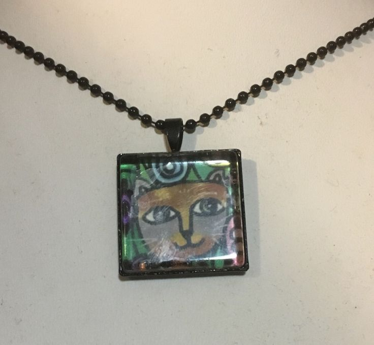 A personal favourite from my Etsy shop https://www.etsy.com/au/listing/496721575/cat-art-pendant-and-black-chain-necklace