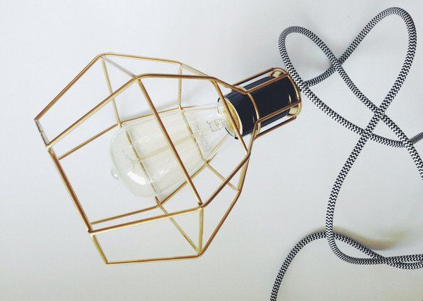 These Industrial-style cage light fixtures are a unique addition to any interior setting. The lights feature an iron geometric shade that encompasses a vintage light bulb to bring alive any space.