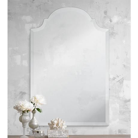 Add a touch of regality to your walls with this lovely crowned mirror design.