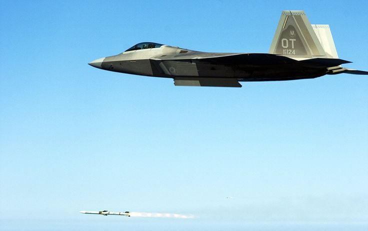 An F/A-22 Raptor from Nellis AFB Releasing a Hughes AIM-120 Air-to-Air Missile.