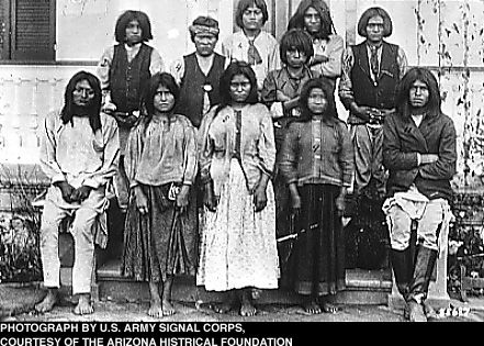 Apache children on arrival at the Carlisle Indian School (Pennsylvania) wearing traditional clothing.