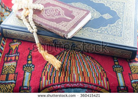 Close up beads and Islamic Book Holy Quran - stock photo