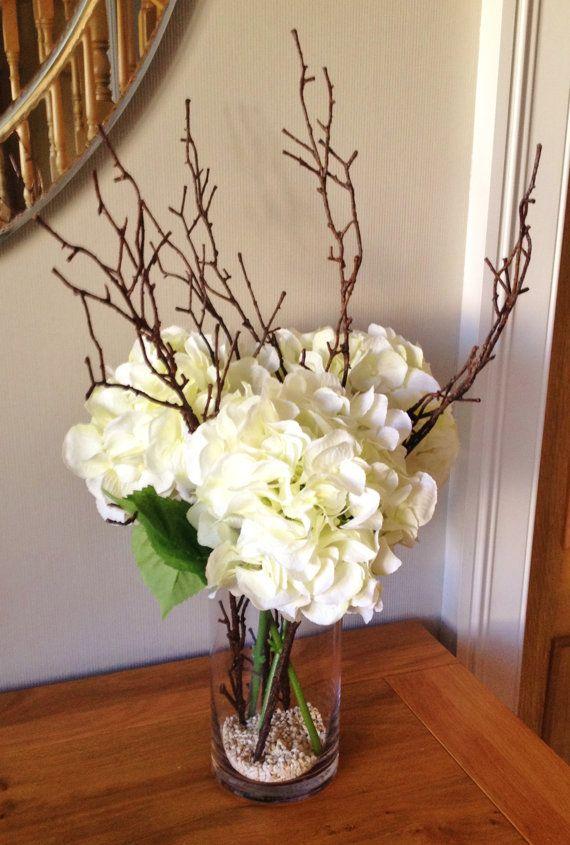 hydrangea floral arrangement with twigs set in still water