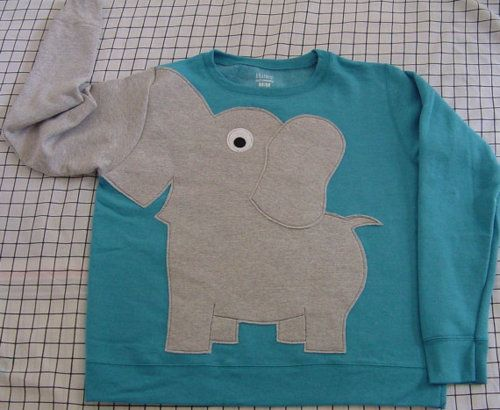 Elephant sweater. The trunk is your right arm. GAH!