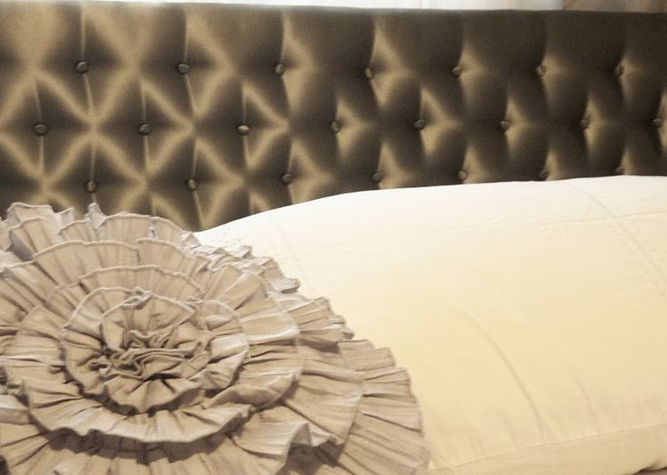 Tufted upholstery adds a rich, luxurious feel to any piece, even a simple head board.  Official upholstery techniques for deep tufting can be quite complicated, but here's a simple way you can get the look with a lot more ease
