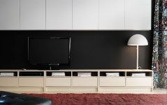 """TV """"disappearing"""" on a black wall (with something to distract the eye above and below) IKEA"""