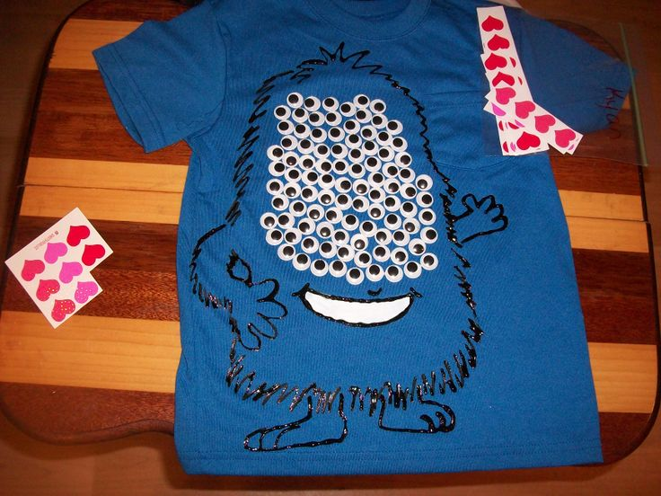 Kyan's 100 Days of School Shirt is 100 wiggly eyes glued onto a t-shirt with puff paints that I used to draw the monster. He then took 100 Valentine Stickers we had bought for his class anyways for his 100 items collection. *Note, fabric glue was used but a few popped off with normal wear so hot glue might have been a better idea.