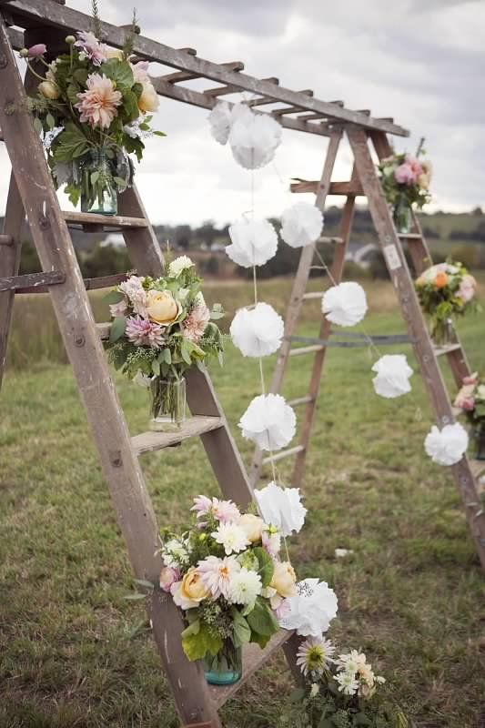 ladders as ceremony center for vintage outdoor garden or beach theme wedding decorate with vines