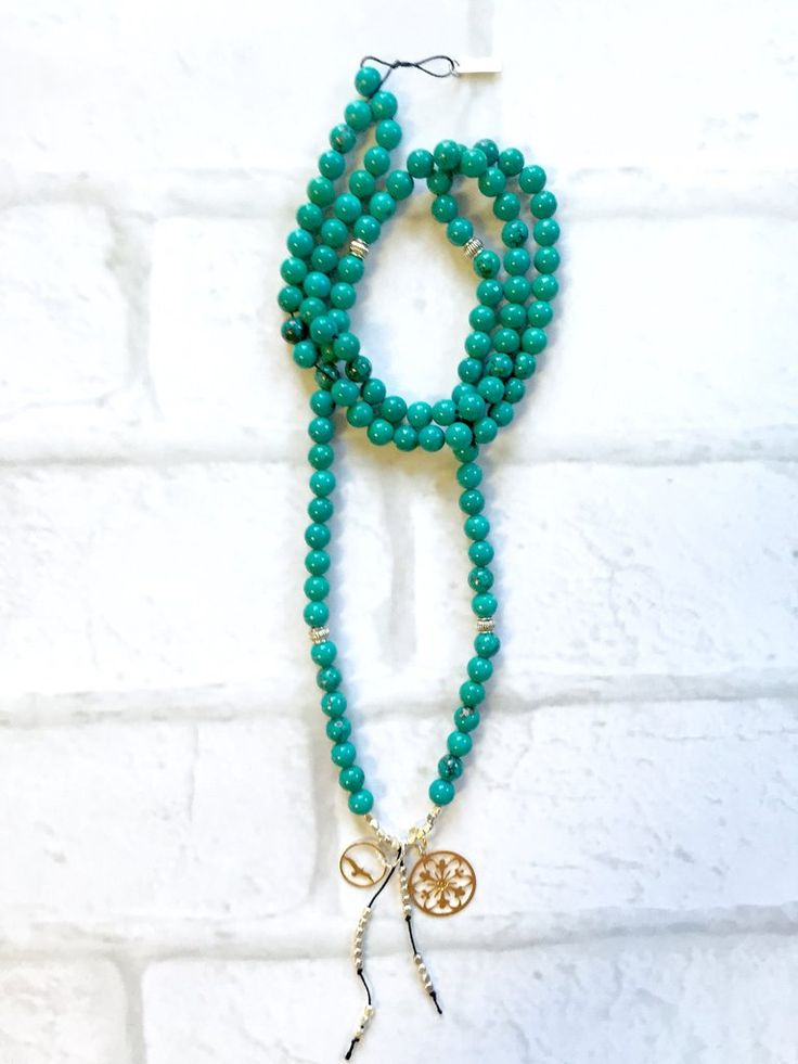 Turquoise  Mala Necklace Intentional jewelry made with turquoise gemstones and sacred geometry pendents. Used during meditation, yoga practice or simply worn as a beautiful piece of jewelry. Each gemstone hold unique healing properties and can be used as a daily reminder of your positive intentions.