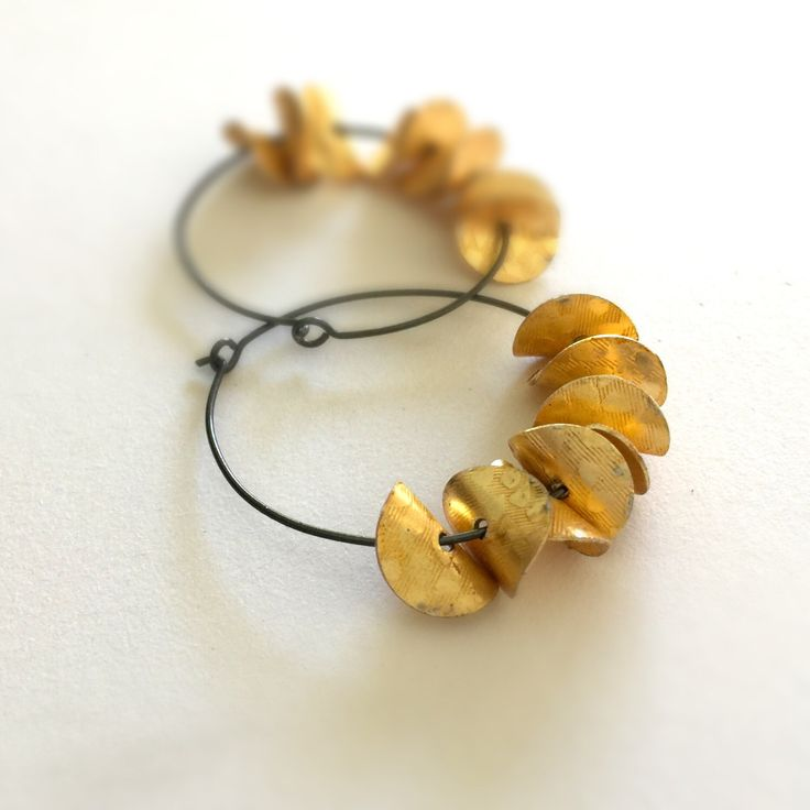 A personal favorite from my Etsy shop https://www.etsy.com/listing/264435968/gold-earrings-oxidized-sterling-silver