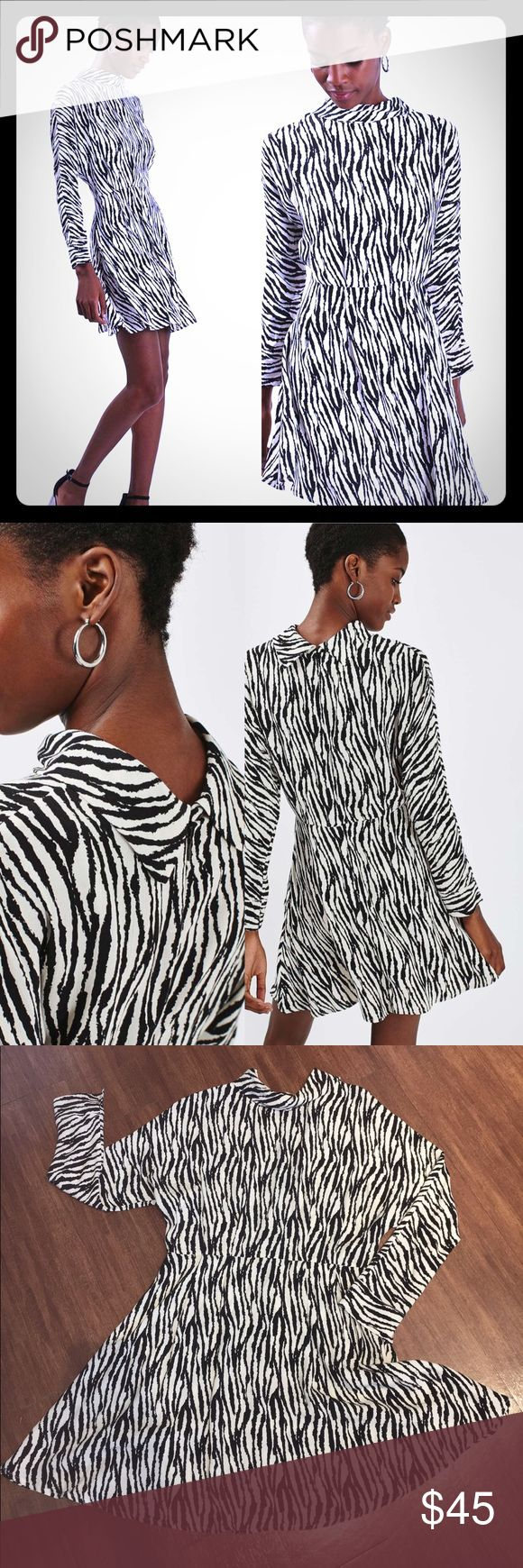 TOPSHOP Roll Neck Zebra Print Dress Sz 6 Opt for bold animal print in this long sleeve dress. Monochrome Zebra design and roll neck style. Wear with block heels for a perfect going out look! Topshop Dresses Mini