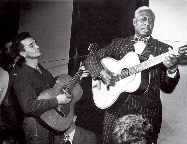 Woody Guthrie and Lead Belly.