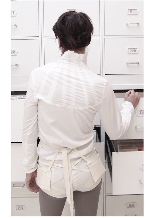 Detail: shirt (cotton), shorts ( wool), belt (wool)