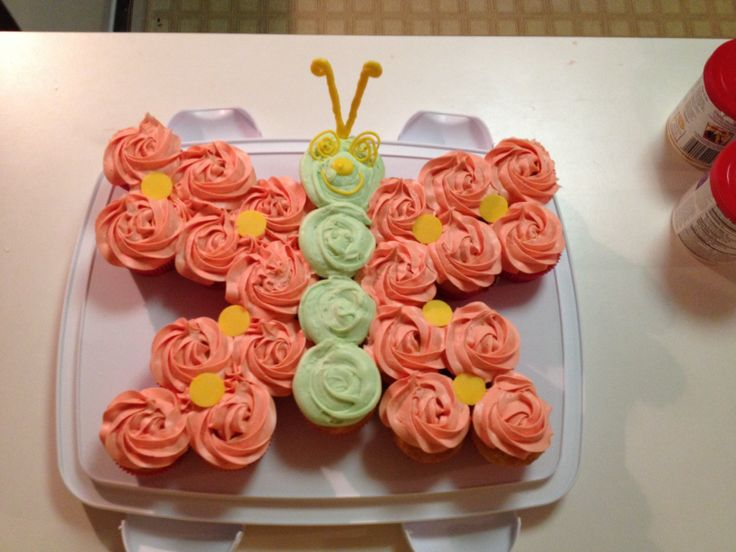 Butterfly cupcake cake for girl birthdays or baby showers .
