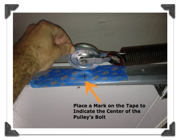 Place a Mark on the Tape to Indicate the Center of the Pulley's Bolt
