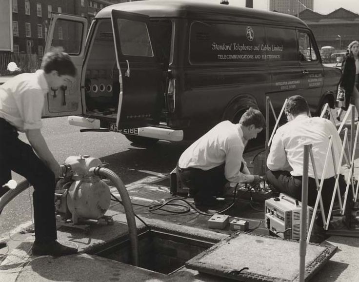 Installation engineers in front of STC installation and maintenance service division van, installing London's first pulse code modulation [PCM] on telephone junction cables in the Waterloo Road, 1967. IET Archives NAEST 211/02/27/02