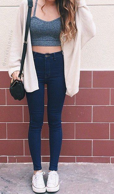 Chunky sweater, crop top, and dark high waisted jeans