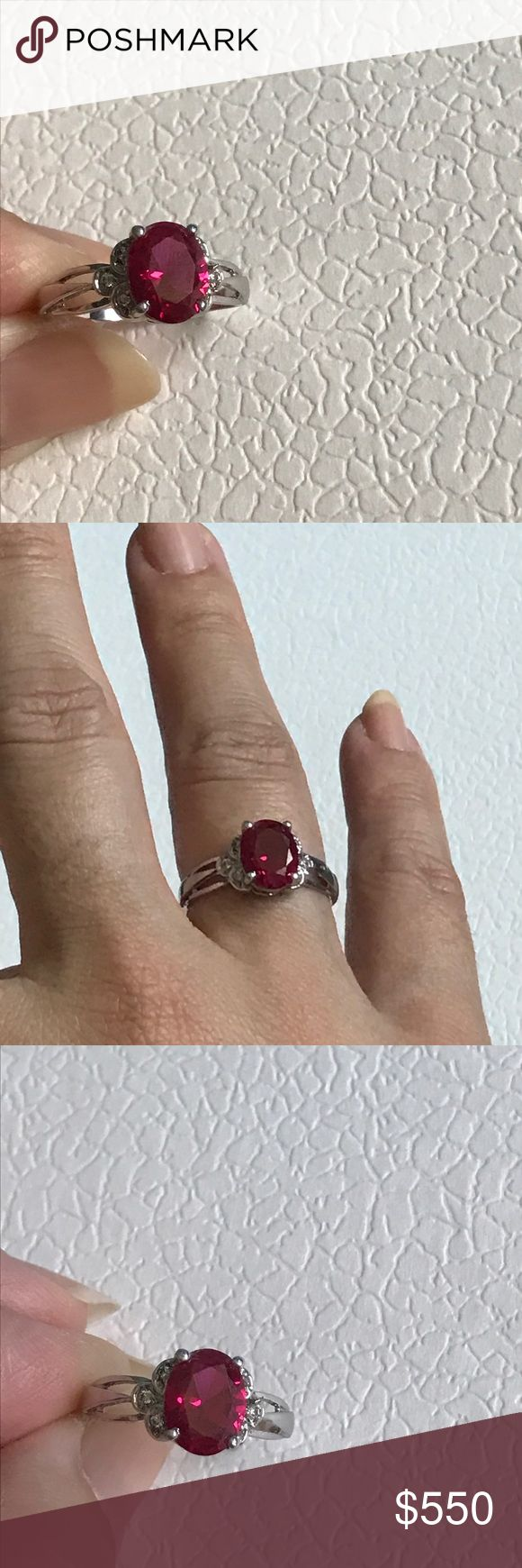 14K white gold natural ruby ring 14K white gold ruby ring with small side white sapphires. Genuine ruby- I don't think it is a lab created stone. Great condition. Approx size 7. Includes jewelry box. Jewelry Rings