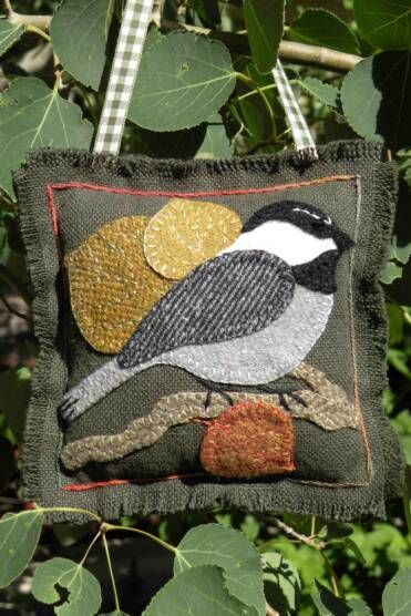 Wool applique.  This site has many cute patterns for sale.
