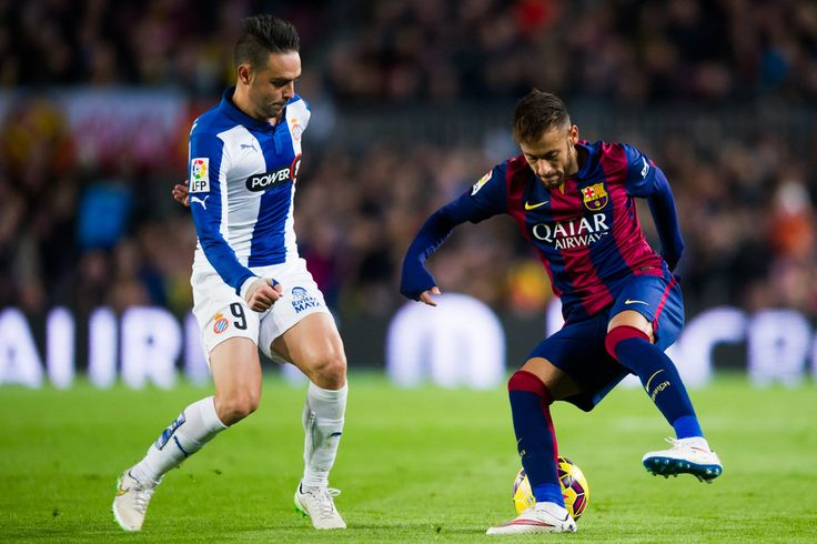 Neymar Santos Jr (R) of FC Barcelona and Sergio Garcia of RCD Espanyol fight for the ball during the La Liga match between FC Barcelona and RCD Espanyol at Camp Nou on December 7, 2014 in Barcelona, Catalonia.