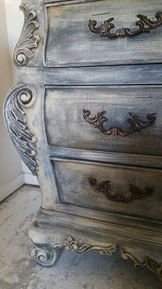 We did this with Annie Sloan graphite, Paris gray, and old ochre then finished with a dark wax glaze.