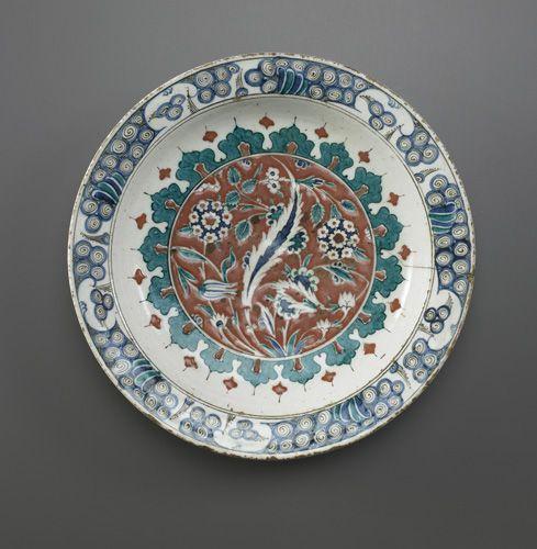 Dish  16th century      Ottoman period     Stone-paste painted under transparent glaze  H: 6.0 W: 33.3 cm   Iznik, Turkey   Freer F1966.21