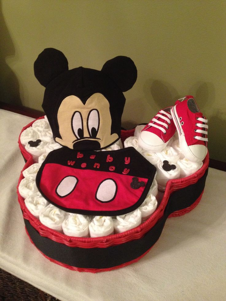 Mickey Mouse diaper basket cake. 55 diapers, hat, bib, shoes and basket.