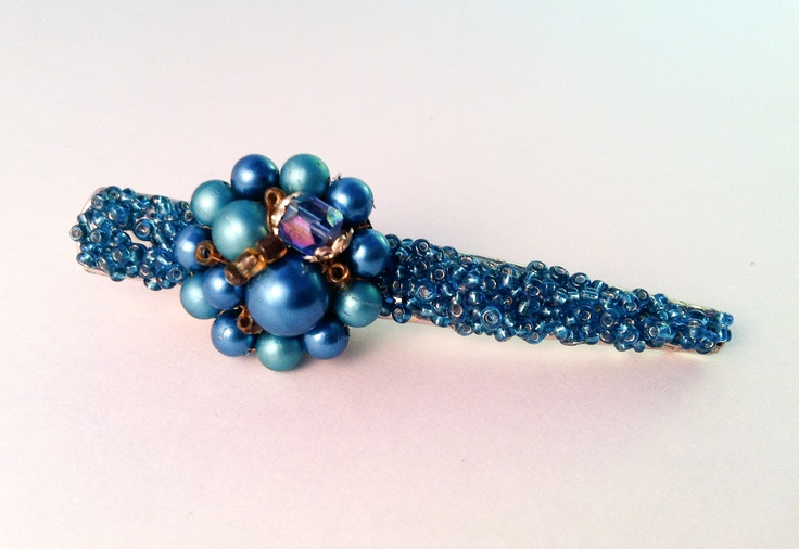 Another vintage earring re-purposed into a lovely hair clip.