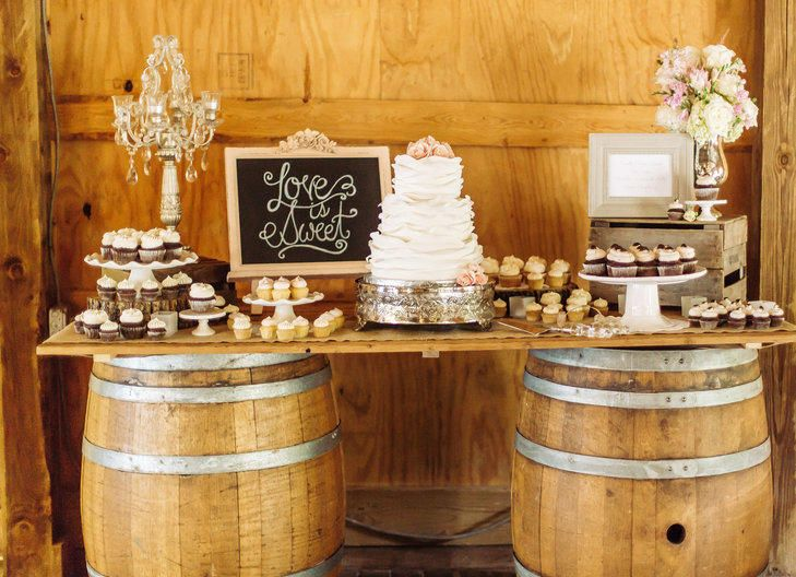 A Wine Cask Dessert Table at a charming, rustic wedding at the Bluemont Vineyard in Bluemont, Virginia. l TheKnot.com