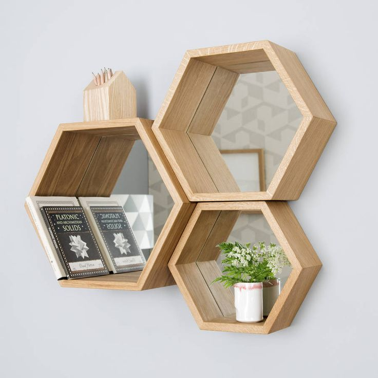 A stunning set of solid wood hexagon mirror shelves A truly unique statement for your home, this set of 3 hexagon shelves also have a mirrored back making them intriguing and incredibly useful.
