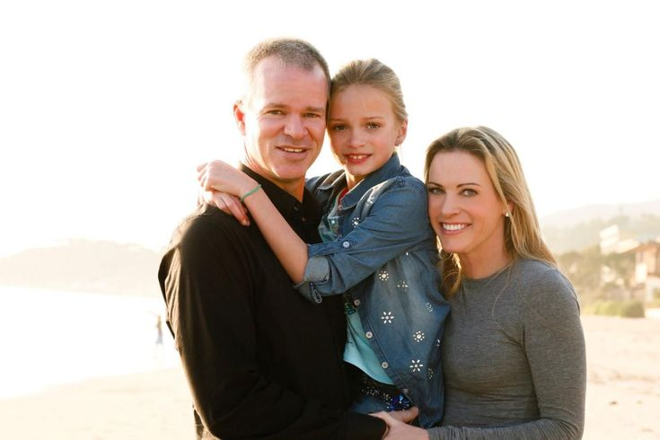 Olympic runner Suzy Favor Hamilton and her husband, Mark Hamilton, with their daughter, Kylie. (Photo courtesy of HarperCollins Publishers) A little more than a decade after champion runner Suzy Favor Hamilton competed in the 2000 Olympics, she was working as a high-priced prostitute in Las Vegas — leaving