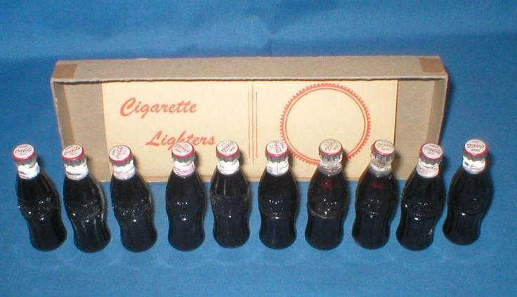 NOS 1950s 10 COCA COLA MINIATURE BOTTLE LIGHTERS IN DISPLAY BOX COKE DRUG STORE?
