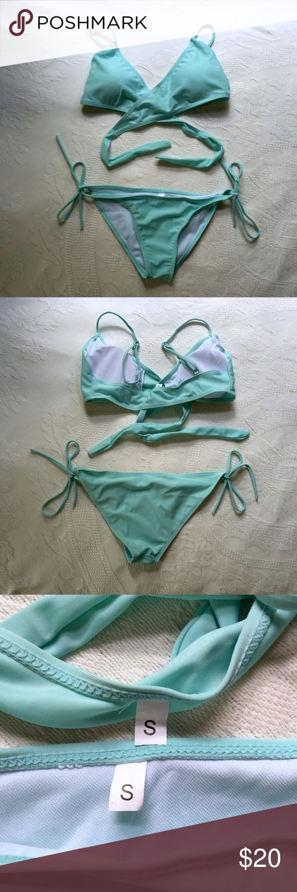 Mint Criss Cross Bikini Mint bikini, ties criss crossed under bust. Top is padded with adjustable straps. Never worn. Listed for views. PINK Victoria's Secret Swim Bikinis