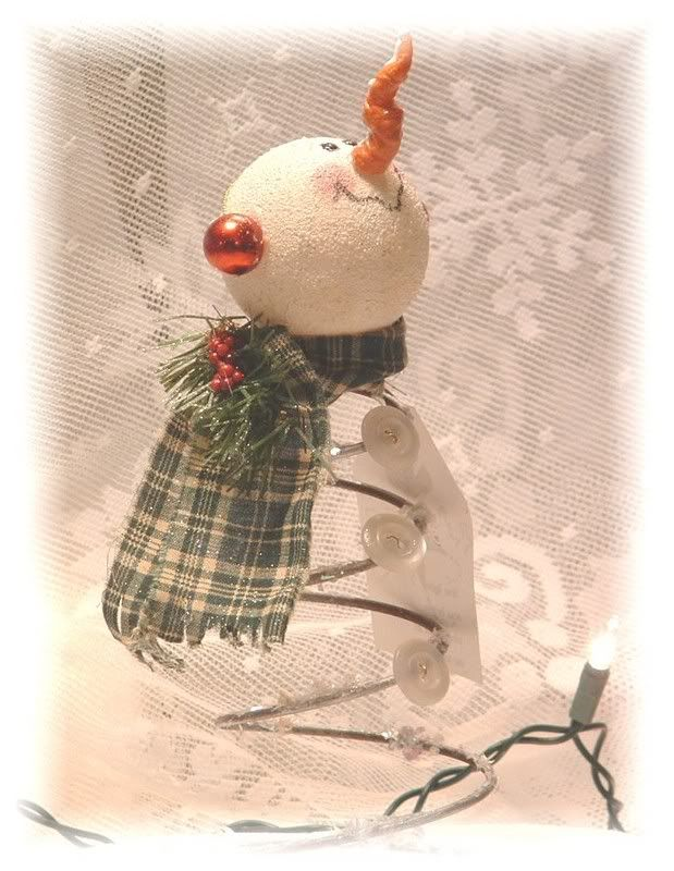 Cute snowman made with rusty bed spring