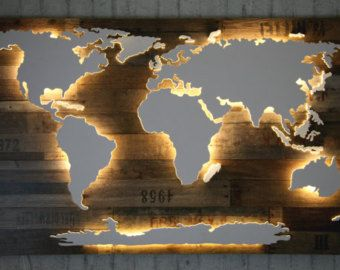 Handmade, unique world map with illumination and 3D-effect in Vintage-style!  The Americas, Africa, Eurasia and the Antarctic are placed slightly higher and are lighted from below by a subtle LED lighting effect. Smaller islands are placed slightly lower and are illuminated in an indirect way, which creates an exciting 3D-effect.  The background consists of dark solid wood with a surface in Vintage-style. This creates an up-to-date Vintage-style, leading to an amazing contrast to the…