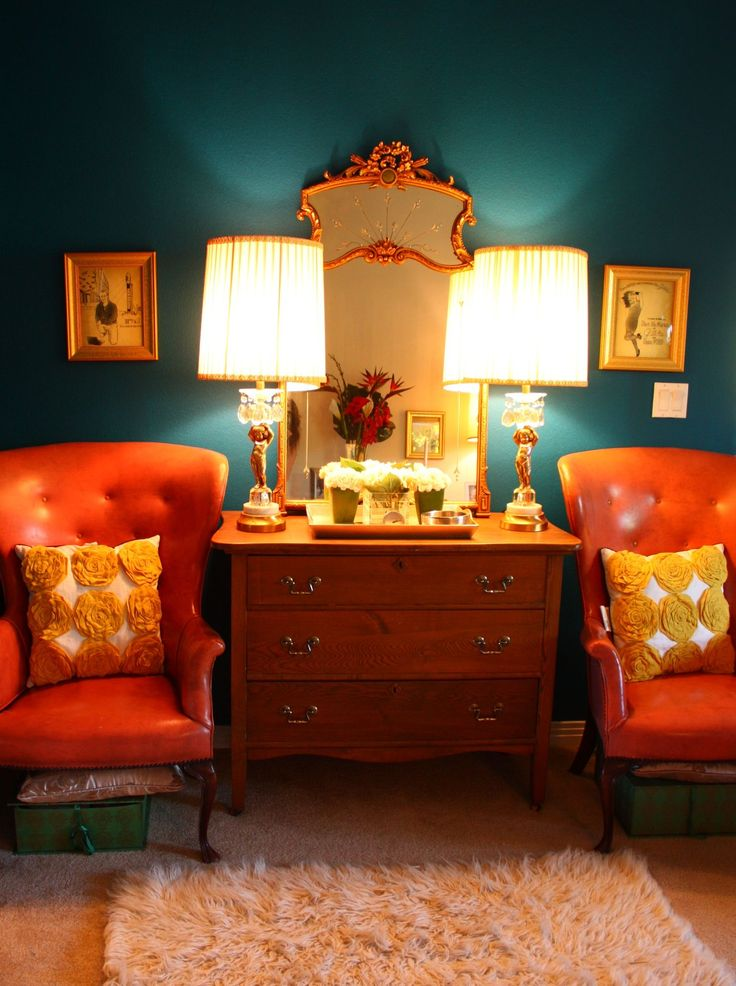 "How do I love thee...let me count the ways! 1. That wall color 2. Orange 3. The shape of the chairs 4. The ""chester"" drawers 5. Twin lamps 6. Shape of the mirrors 7. Those throw pillows 8. Green storage boxes under orange chairs"