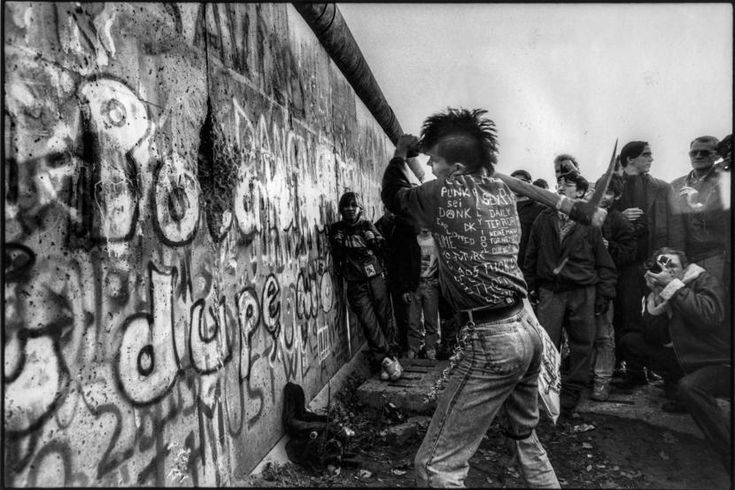 A punk from West Berlin helps to tear down the Berlin Wall, Nov. 9, 1989. Justin Leighton/Redux