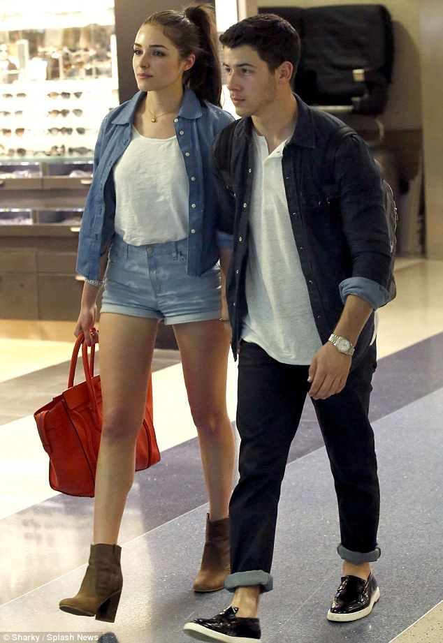 Legging it around LAX: Nick Jonas holds hands with his Miss Universe girlfriend Olivia Culpo at LAX after the couple flew in from Hawaii on Wednesday