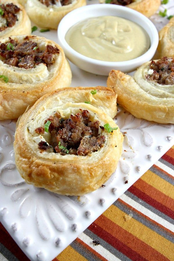 These Sausage Pinwheels are great mess free appetizers, no gooey or sticky fingers this time around, except when dipping in a honey mustard sauce. And did I mention they'realso super easy to make.   #appetizer #chives #parmesan cheese #puff passtry #sage #sausage